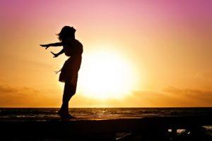 woman sunset ocean beach one great gut Ayurvedic Medicine Dr. Christine Tara Peterson